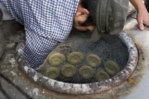 Muslimsk bager med tandooriovn